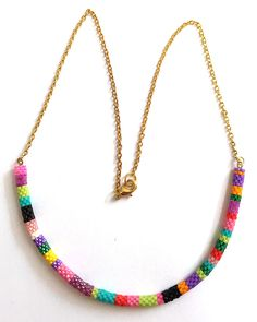 Nita E Kaufman - playing with color bands in a bracelet format but attaching a chain to make a necklace.