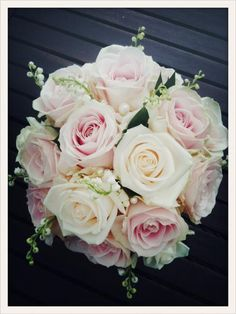 Beautiful bridal bouquet made with Avalanche+ and Sweet Avalanche roses by Meijer Roses!