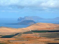 Part of Chinijo Archipelago from Lanzarote; Nearest island La Graciosa, centre Montana Clara, and far-most Alegranza