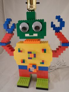 Hey, I found this really awesome Etsy listing at https://www.etsy.com/listing/155252662/kids-robot-lego-r-lamp