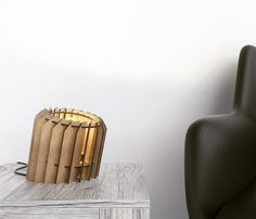 Leanio is a minimalistic and cool wooden table lamp with a playfull attitude. It looks nice on the side table but also on your desk. Leanio creates a unique pattern on the surface of your desk when turned on.