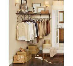Pottery Barn New York Shelf & Clothes Rack in Rustic Iron...LOVE the look of stacked photos on the shelf