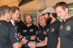 Prince Harry presenting Cayle Royce of Row 2 Recovery his Atlantic medal