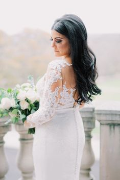 real wedding photo at oheka castle long island new york classic wedding dress buttons down back lace illusion bodice pronovias long hair