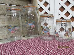 Vintage Arc France 4 piece Glass Canister Set Made in France Heartland Pattern Country Cottages 1 sizes by EvenTheKitchenSinkOH on Etsy Arc France, Glass Canisters, Canister Sets, Heartland, Etsy Store, Vintage Items, Mason Jars, Glass Vase, Country Cottages