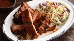 Slow-Cooker Barbecued Ribs — Make these fall-off-the-bone ribs in the slow cooker. How easy does that sound? These ribs are a great main dish for when friends come over to watch the game. Slow Cooker Barbecue Ribs, Crock Pot Slow Cooker, Slow Cooker Recipes, Crockpot Recipes, Cooking Recipes, Potluck Recipes, Dinner Crockpot, Rib Recipes, Healthy Recipes