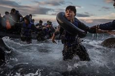 After battling rough seas and high winds from Turkey, migrants arrived by rubber raft on a jagged shoreline of the Greek island of Lesbos. Fearing capsize or puncture, some panicked and jumped into the cold water in desperation to reach land. This boy made it, unlike hundreds of others. Oct. 1, 2015. Tyler Hicks/The New York Times