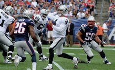 Derek Carr #4 of the Oakland Raiders passes the ball during the third quarter against the New England Patriots at Gillette Stadium on September 21, 2014 in Foxboro, Massachusetts.