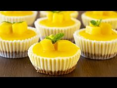 Come and try these creamy no-bake mini mango lassi cheesecakes. These are quick ones that you don't need to chill overnight. Perfect dessert for the summer! Köstliche Desserts, Summer Desserts, Delicious Desserts, Mango Cheesecake, Cheesecake Recipes, Cupcakes, Road Trip Essen, Road Trip Food, Mango Cake