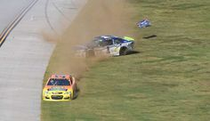 2017 NASCAR Wrecks - November 19, 2017:  NASCAR: ALABAMA 500 -  Monster Energy NASCAR Cup Series driver Jamie McMurray (1) slides in to the infield behind Chris Buescher (37) after a collision during the Alabama 500 at Talladega Superspeedway.