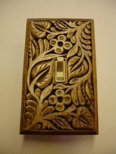 Switch plate made of wood hand carved by creativemind44 on Etsy, $22.00