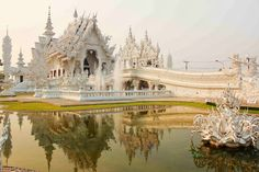 A beautiful white temple in Thailand is decorated with silver glittering pieces of mirrors. There are large mural paintings of the Lord Buddha in different gestures.  To Read More  http://historicwonders.blogspot.com/2013/11/white-palace-bangkok-thailand.html