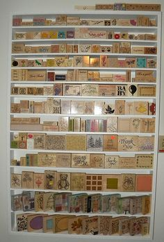 Here is my rubber stamp wall.  I still have my foam stamps and my cling stamps to organize.  My husband built this for me.  It's approximately 4.5 feet by 3 feet.  I didn't think I was going to fill it up!!!  I have these and still am uncovering more stamps!   Find it at Ruthie's Girl Designs