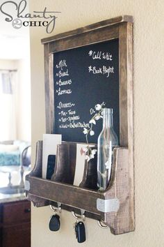 Every entryway needs a chalkboard with key hooks! #design #functional #home  Courtesy of Shanty 2 Chic!