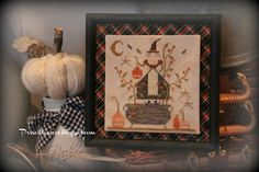 Priscillas -  I used a thrift store frame ( it was 25 cents ) ..spray painted it with chalkboard paint .. then I used Halloween colored Homespun fabric to mount over the mat board in the frame( on the bias) . I used stitcky needlework board to mount the stitching ..then glued that to the top of the homespun matboard.