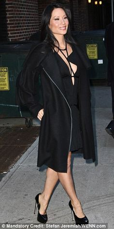 Lucy Liu at the Late Show wearing a cleavage revealing strappy little black dress and high heels. She is a favorite and gorgeous. #Lucy_Liu #legs