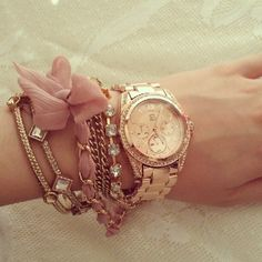 Stacked bracelets and watch