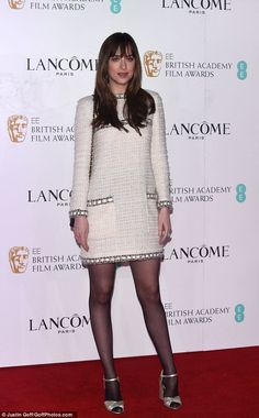 Looking chic: Dakota Johnson showed off her sharp sense of style at Saturday night's Lancome Pre-BAFTA party held in the regal setting of London's Kensington Palace