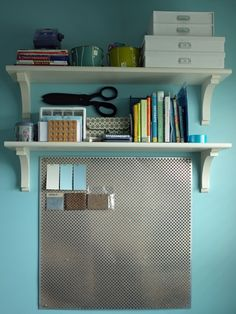 Mixing cork tiles and an aluminum radiator grate to create a modern cork board for real-life pinning.