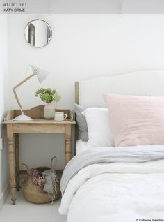 K & H Interiors - We absolutely love this design! The country style bedside table mixed with the contemporary accessories and bedding give it a sophisticated look. Love the pop of Rose Quartz pillow as well!