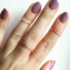 A set of three rose gold rings, includes two midi rings and one spiral ring. The spiral ring is according to standard sizing and the other two rings are made smaller to become midi rings.  Handmade using 18 gauge rose gold wire.  Rings can be adjusted from the back if need be.  Please avoid contact with liquids to preserve the longevity of the rings.  GirlMakesRings x