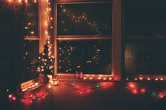 wish my house had a porch...to hang lights in the windows... <3