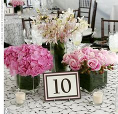 Crisp white tablecloths embroidered with a brown floral pattern were topped with three vases filled with pink roses, hydrangeas, and orchids.  from the album: Alison & Daniel: An Outdoor Wedding in Canton, MA