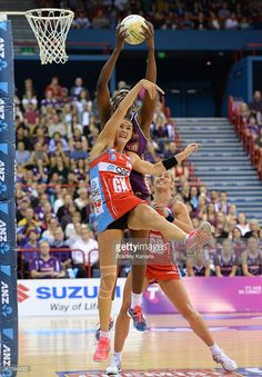 Romelda Aiken of the Firebirds gets above Sharni Layton of the Swifts during the 2015 ANZ Championship Grand Final match between the Firebirds and the Swifts at Brisbane Entertainment Centre on June 21, 2015 in Brisbane, Australia.