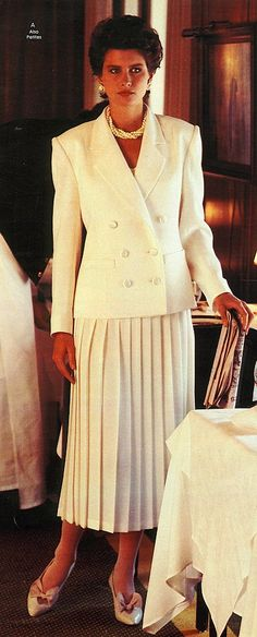 """This is an example of the 1980s daytime dress. It was a """"power suit"""" that women in the working world wore. The power suit was conservative and business-like because of where it was worn  during the day at the workplace."""