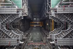 A view from below in High Bay 3 inside the Vehicle Assembly Building at NASA's Kennedy Space Center shows three work platforms installed for NASA's Space Launch System (SLS) rocket. The platforms will surround and provide access to the SLS rocket and Orion spacecraft for Exploration Mission 1.