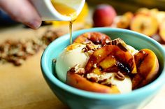 GRILLED PEACHES & PECANS WITH VANILLA ICE CREAM Fresh Peaches, Halved And Pitted Maple Syrup, For Brushing Butter (for Grilling) Pecans, Chopped Preparation Instructions Brush the peach halves with maple syrup. Smear butter on a grill or grill pan over low heat. P Remove the peaches when they're slightly soft but not mushy and have great grill marks. Brush a little extra maple syrup over the tops. Serve them: .