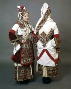 Bulgarian Traditional Folk costume with a white sayás (sleeved coat dress) full of impressive embroidered and woven gold and multicoloured motifs from the Bulgarian village Episkopi (Piskopiya), Florina