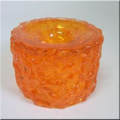 Whitefriars tangerine glass 'Bark' candle holder, from the 'Textured' range, designed by Geoffrey Baxter, pattern number 9733.