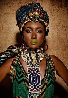 This model is wearing African tribal attire in an editorial style photo shoot. The look has been modernized to some level with the makeup and modernized clothing.