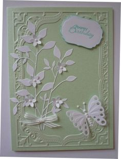Use either frame folder or Nestabilities dies and butterfly die from corner die set with memory box foliage die.
