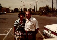 Couple Posing By Car Vintage  Color  Photo    by foundphotogallery
