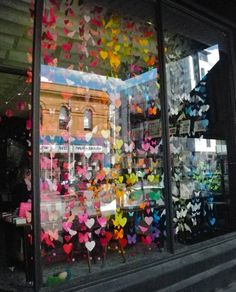 Hundreds of paper birds, butterflies and hearts in the window of Kami on Brunswick St.