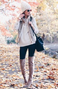 winter outfit: over the knee boots and leather leggings with lace up sweater and fur vest