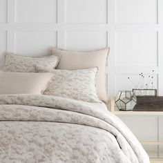 Pine Cone Hill Water Mill Natural Matelassé Coverlet. Build your bedroom oasis with this refreshing take on a cotton matelassé coverlet, featuring a unique splatter pattern reminiscent of a crashing waterfall in versatile neutrals.