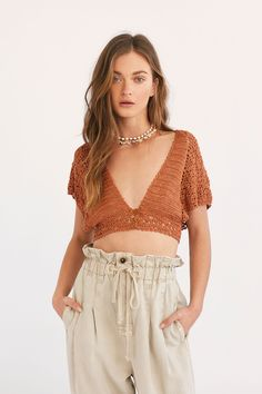 Slide View Frill Edge Crochet Crop Top Boho crochet top featured in a cropped silhouette with a plunging V-neckline. * Front button closures * Wide short sleeves * Open back * Adjustable tie at the back waist and neck Crochet Top Outfit, Crochet Blouse, Crochet Clothes, Diy Clothes, Knit Crochet, Crochet Summer Tops, Crochet Crop Top, Crochet Tops, Knit Tops
