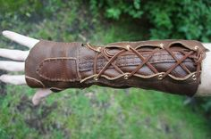 Leather Archery Bracer, I will be making zis. I just think it looks cool