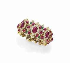 A RUBY, DIAMOND AND EMERALD BRACELET, BY DAVID WEBB Designed as a row of oval cabochon rubies, each within a circular-cut diamond and smaller oval cabochon ruby articulated plaque, spaced by circular-cut emerald, diamond and cabochon ruby foliate links, mounted in 18k gold.