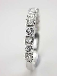 Wedding Ring with Round and Princess Cut Diamonds