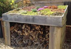 Vertical Kayak Storage log store with planting on roof Green Roof Benefits, Log Shed, Garbage Shed, Green Facade, Green Roofs, Log Store, Living Roofs, Firewood Storage, Shed Homes