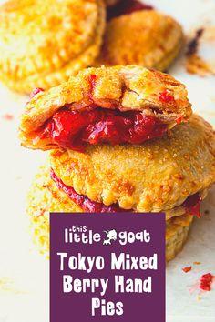 Cook Time: 25 minutes Servings: 4 servings Ingredients: • 1 cup diced strawberries • 1 cup fresh raspberries • 1/4 cup granulated sugar • 2 Tbsp cornstarch • 2 Tbsp This Little Goat went to Tokyo • 1 Tbsp fresh lemon juice • 1 tsp fresh lemon zest • 1/2 tsp kosher salt • 1 box (2 sheets) pre-made pie dough • 1 egg yolk • 1/4 cup turbinado sugar Cover Photo Credit: Page & Plate Goat Recipes, Raspberry, Strawberry, Mixed Berries, Hand Pies, 1 Egg, Granulated Sugar, Fresh Lemon Juice, Corn Starch