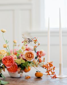 Antike roses, Distant Drum roses, rananculus, bittersweet, eucaluptus, porcelin vines, persimmon Ashley Beyer
