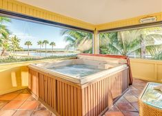 Plan a multi-family escape to a spacious home with 2 living rooms and 2 kitchens. Nestled in the sand on the Fort Myers beachfront, this Gulf Coast oasis offers water views from the private pool, hot tub, and sprawling deck. Beach Kitchens, Fort Myers Beach, Beach Vacation Rentals, South Island, Lanai, Coastal Homes, Rental Property, Private Pool, Tub