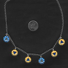 Zelda- Make it Rain, Song of Storms Ocarina of Time necklace on Etsy for $25.