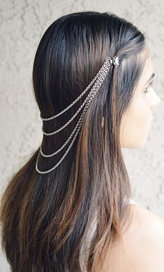 http://natural-hairs.com/17-unique-updo-styles-weaved-braiding-bridal-chic/ bridhair clip and chain... love the cascade the multi-stand chain creates.
