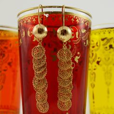 Very pretty crocheted earrings from Milena Zu to add a little glamour to your outfit. Handmade little coins crocheted with copper wire and gold plated.  $120  http://www.crowdedsilver.com.au/store/earrings-c-357.html  #SilverEarrings